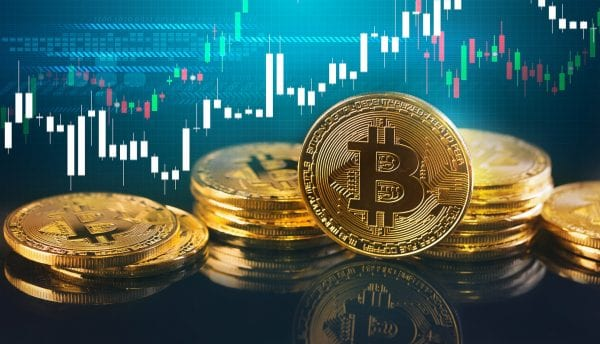Bitcoins and New Virtual money concept.Gold bitcoins with Candle stick graph chart and digital background.Golden coin with icon letter B.Mining or blockchain technology