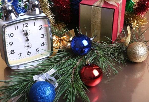 Colored balls , clock and gift boxes on christmas background